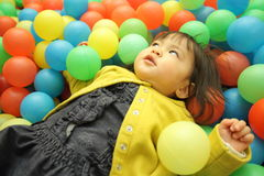 Japanese baby girl playing in ball pool Stock Image