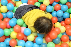 Japanese baby girl playing in ball pool Royalty Free Stock Photo