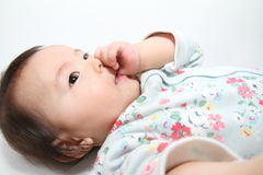Japanese baby girl sucking her finger Stock Images