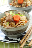 Japanese bambooshoot rice. Japanese flavored pilaf takigomi gohan with mushroom, bamboo shoot and carrot Stock Image