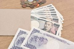 Japanese banknotes and coins Stock Photos