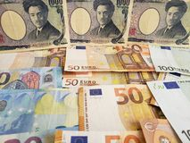 Japanese banknotes and euro bills. Closeup, forex, foreign, jpy, yen, europe, european, commerce, exchange, travel, trade, trading, value, buy, sell, profit stock photography