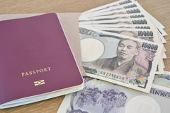 Japanese banknotes with passport Royalty Free Stock Images