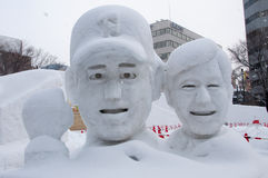 Japanese baseball coach with his player, Sapporo Snow Festival 2013 Stock Photos