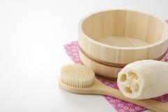 Japanese bath image. Body brush, loofa and keg on towel of japanese bath image Stock Image