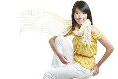 Japanese beauty with windswept hair, yellow scarf. Beautiful japanese girl with windswept hair and yellow scarf flying with wind. Shot in studio isolated against Stock Images