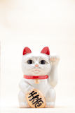 Japanese beckoning cat called Manekineko Stock Photography
