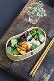 Japanese bento box lunch. Bento box with onigiri, prawns and vegetables royalty free stock image
