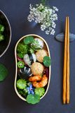 Japanese bento box lunch. Bento box with onigiri, prawns and vegetables stock photos