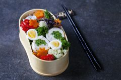 Japanese bento lunch. Japanese bento box with chicken stuffed with asparagus, rice, vegetables and quail eggs stock images