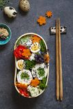 Japanese bento lunch. Japanese bento box with chicken stuffed with asparagus, rice, vegetables and quail eggs stock image