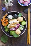 Japanese bento bowl lunch. Japanese bento style lunch with onigiri, prawns, chicken and vegetables from above royalty free stock photos