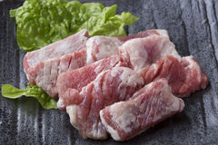 Japanese Black Wagyu Kappa red meat with lettuce on black dish Royalty Free Stock Images