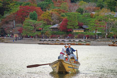 Japanese boatman sail boat to enjoy autumn leave Stock Image