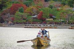Japanese boatman sail boat to enjoy autumn leave Stock Image