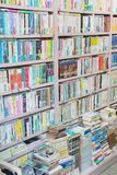 Japanese books arranged in order on wooden bookcases. Photo taken in Kyoto Japan on the 18.05.2016 royalty free stock photos
