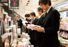 Japanese bookshop. Readers in bookshop in the Ginza, Tokyo Japan. March 9, 2010 Royalty Free Stock Photo