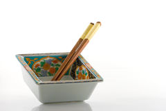 Japanese Bowl and Chopsticks. Square japanese food bowl and two chopsticks Stock Image