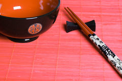 Japanese bowl and sticks. Eastern style Stock Image