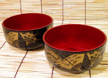 Japanese bowls. Traditional Japanese bowls on a bamboo straws floor Royalty Free Stock Images