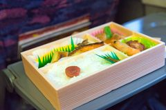 Japanese box lunch. Bento - Japanese food box set which compose of rice, tofu, fish with soy sauce, fried chicken serve Stock Image