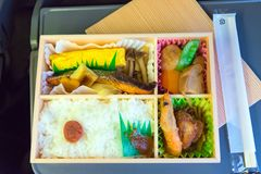 Japanese box lunch. Bento - Japanese food box set which compose of rice, tofu, fish with soy sauce, fried chicken serve Stock Photos