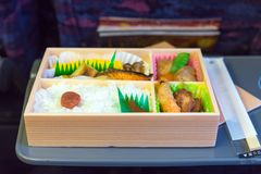 Japanese box lunch. Bento - Japanese food box set which compose of rice, tofu, fish with soy sauce, fried chicken serve Stock Photo