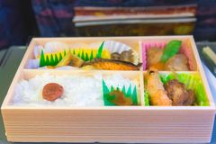 Japanese box lunch. Bento - Japanese food box set which compose of rice, tofu, fish with soy sauce, fried chicken serve Royalty Free Stock Photos