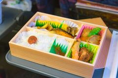 Japanese box lunch. Bento - Japanese food box set which compose of rice, tofu, fish with soy sauce, fried chicken serve Stock Images