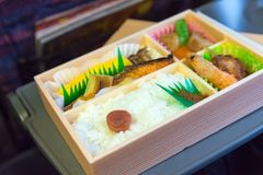 Japanese box lunch. Bento - Japanese food box set which compose of rice, tofu, fish with soy sauce, fried chicken serve Royalty Free Stock Images
