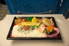 Japanese Box in Shinkansen or bullet train. Japanese Lunch Box & x28;Bento& x29; on Japanese Bullet train, Shinkansen royalty free stock images