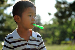 Japanese boy blowing bubbles Royalty Free Stock Image