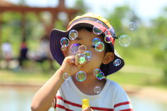 Japanese boy blowing bubbles Royalty Free Stock Photos