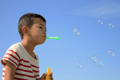 Japanese boy blowing bubbles Royalty Free Stock Images
