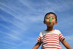 Japanese boy blowing bubbles. (4 years old Stock Image