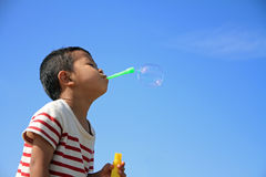Japanese boy blowing bubbles Stock Photography