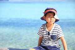 Japanese boy and blue ocean Stock Images