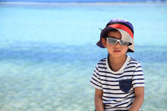 Japanese boy and blue ocean Stock Photo