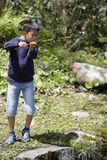 Japanese boy catching fish royalty free stock photo