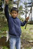 Japanese boy catching fish royalty free stock photos