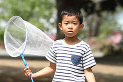 Japanese boy collecting insect stock photo