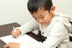 Japanese boy doing homework. First grade at elementary school Stock Photos