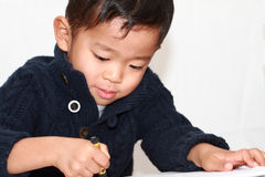 Japanese boy drawing a picture Royalty Free Stock Image