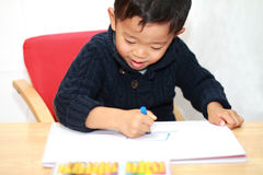 Japanese boy drawing a picture Stock Image