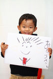 Japanese boy drawing a picture Stock Photos