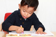 Japanese boy drawing a picture Royalty Free Stock Photo