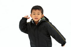 Japanese boy having snowball fight Royalty Free Stock Photos