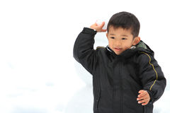 Japanese boy having snowball fight Royalty Free Stock Images