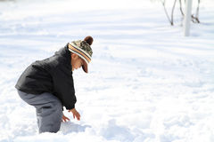 Japanese boy having snowball fight Stock Image
