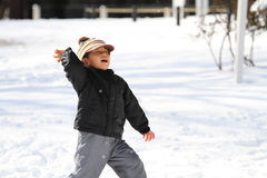 Japanese boy having snowball fight Stock Images